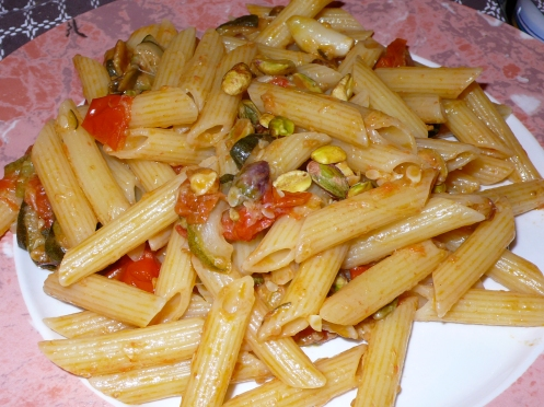 penne with zucchini, roasted tomatoes and pistachios